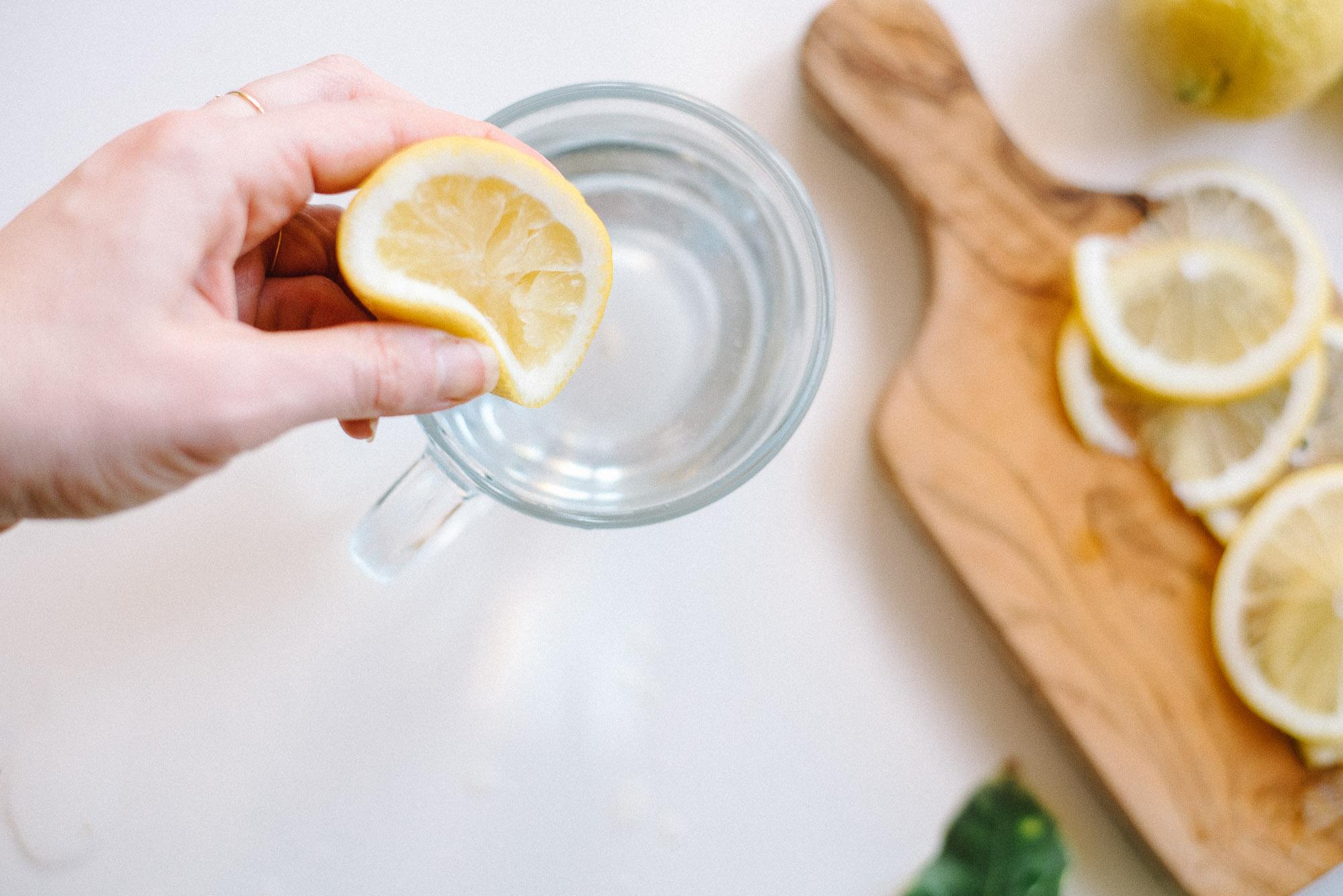 hand-squeezing-lemon-water | Kale & Caramel